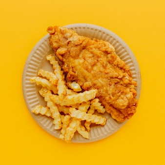 Top view of fish and chips on plate