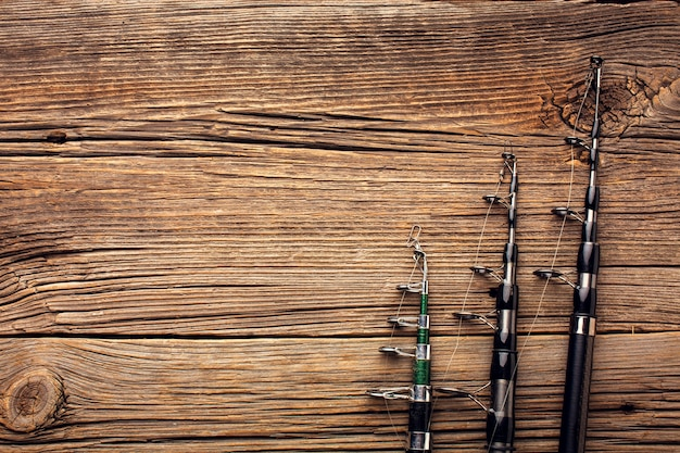Top view of fishing rods with copy space