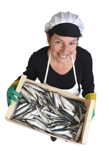Top view of fishmonger holding a box of sardine on white background