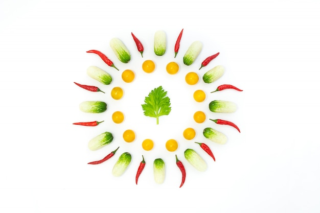 Top view flat lay over cucumbers, cherry tomatoes, celery and pepper