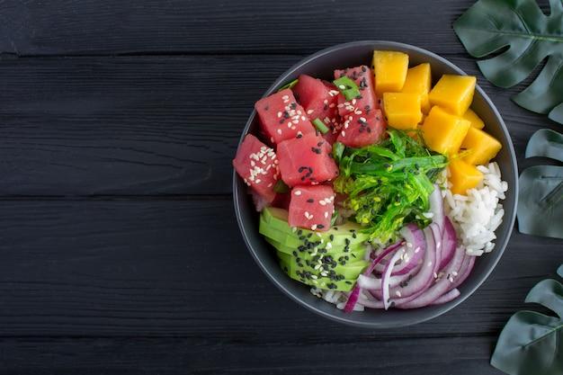 Top view flat lay of poke salad bowl