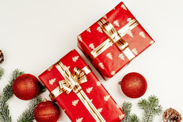 Top view flat lay of red christmas gifts on white background