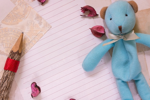 Top view flat lay shot of letter paper envelope and pencil cute bear doll