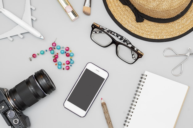 Top view flat lay, woman's travel and vacation concept items