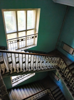 Top view on the flight of stairs of a tall old building