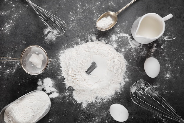 Top view flour with baking tools on the table