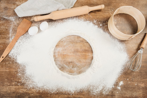 Top view of flour on wooden surface