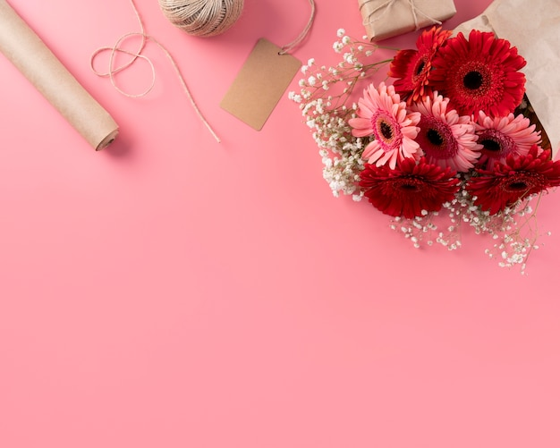 Top view of flowers bouquet with gift