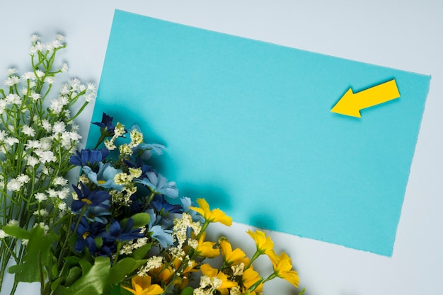Top view flowers bouquet with greeting card