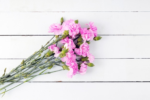 Top view flowers bouquet on wooden background