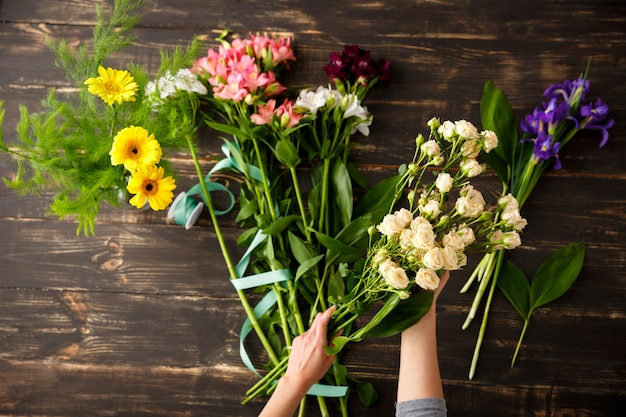 Top view of flowers, florist in process of making bouquet