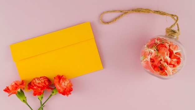 Top view flowers with envelope