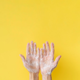 Top view of foamy hands with copy space