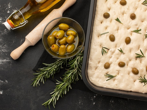 Top view focaccia dough with olives