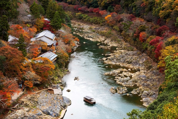 Top view fof hozu river with autumn colors from arashiyama view point, kyoto, japan
