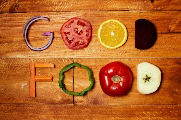 Top view food arrangement on wooden background