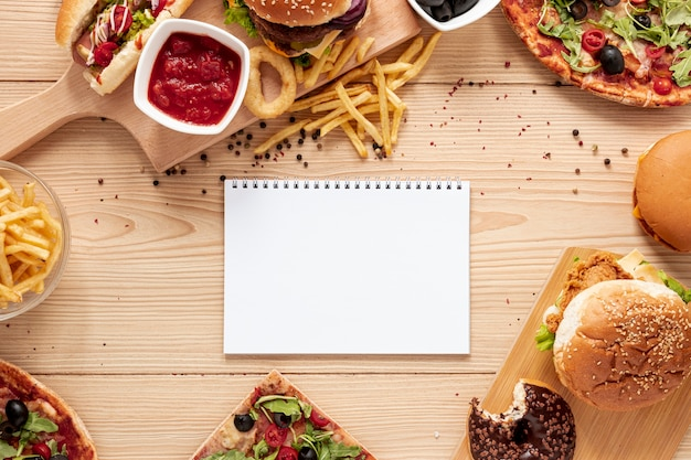 Top view food assortment with notebook