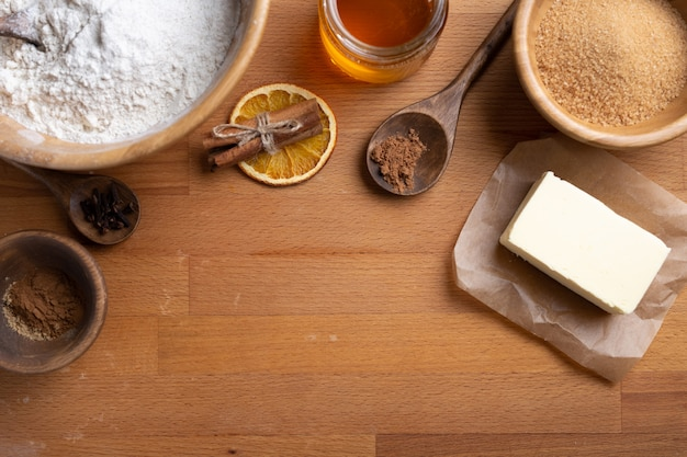 Top view of food ingredients with copy space for recipe. flour, butter, sugar, spices. new year concept.