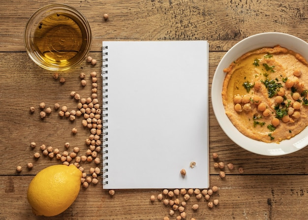 Top view of food ingredients with notebook and chickpeas