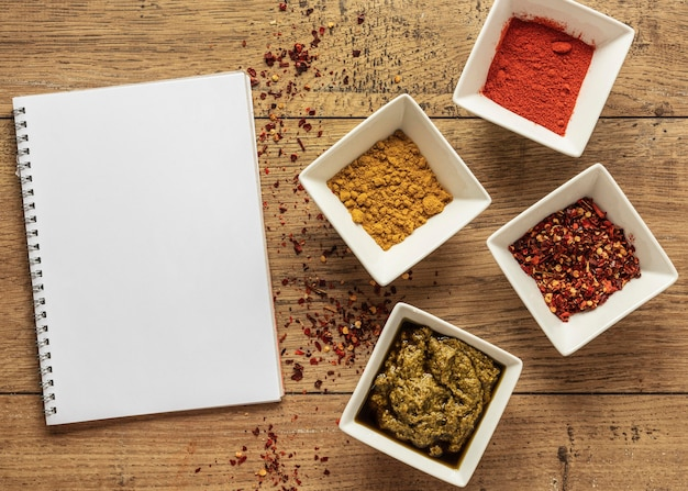 Top view of food ingredients with notebook and spices