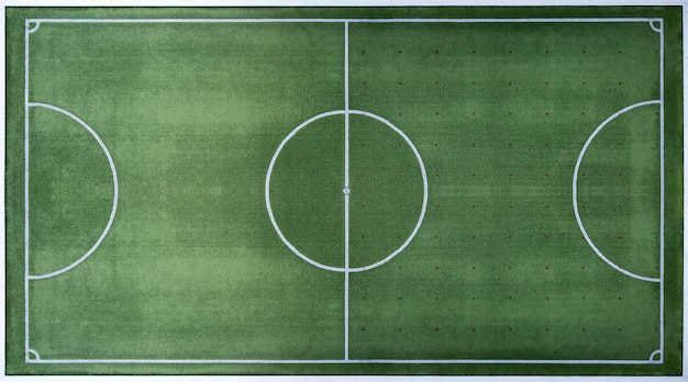 Top view of football field, soccer field with white border lines