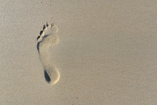 Top view on footprint in the sand
