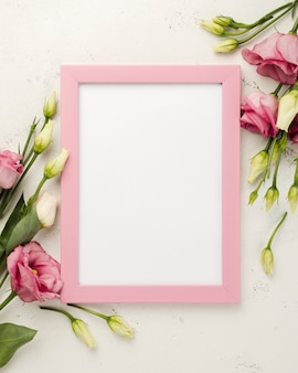 Top view frame beside roses