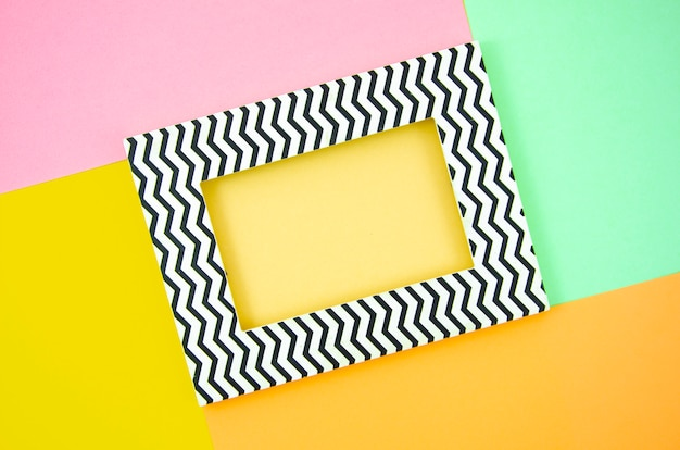 Top view frame on a pop pastel colors background