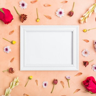 Top view of frame with assortment of spring flowers and roses