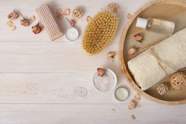 Top view frame with bath items on wooden background