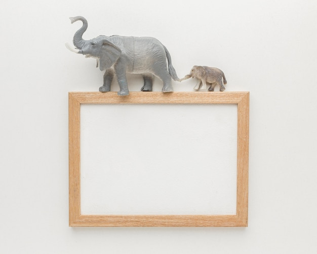 Top view of frame with elephant figurines on top for animal day