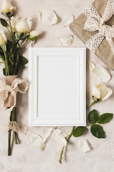 Top view of frame with gift and rose bouquet