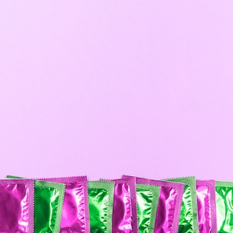Top view frame with green and pink condoms