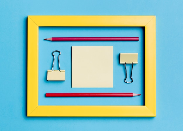 Top view frame with paper clips and pencils