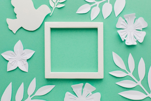 Top view of frame with paper dove and leaves