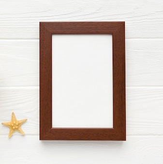 Top view frame with starfish on the table