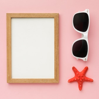 Top view frame with summer glasses concept