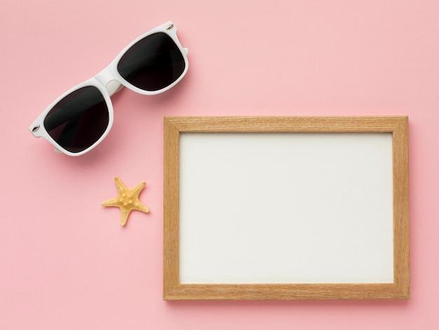 Top view frame with summer glasses