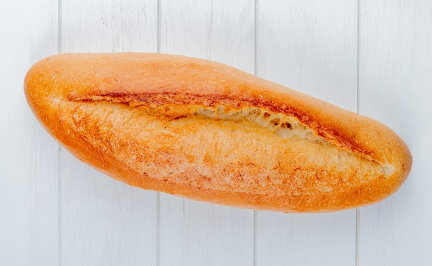Top view of french baguette on wooden table