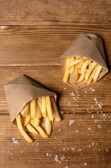 Top view of french fries with salt