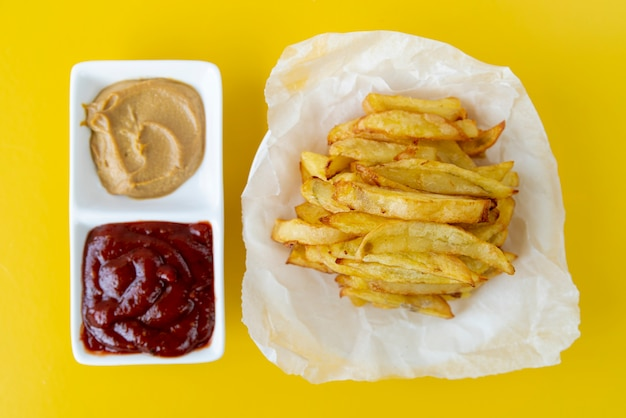 Top view french fries with yellow background