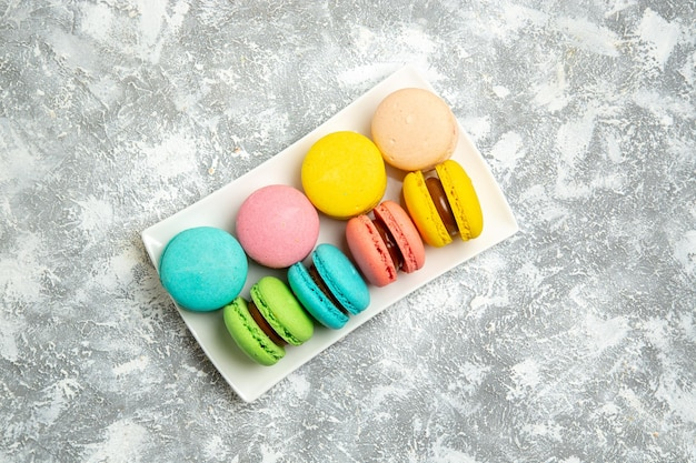 Top view french macarons ful cakes on the white surface