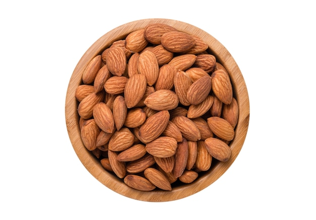 Top view of fresh almonds nut in wooden bowl