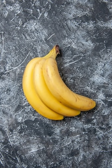 Top view fresh bananas on grey background