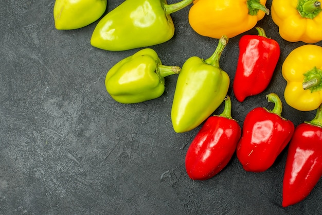 Top view fresh bell-peppers on dark background salad food meal ripe photo color