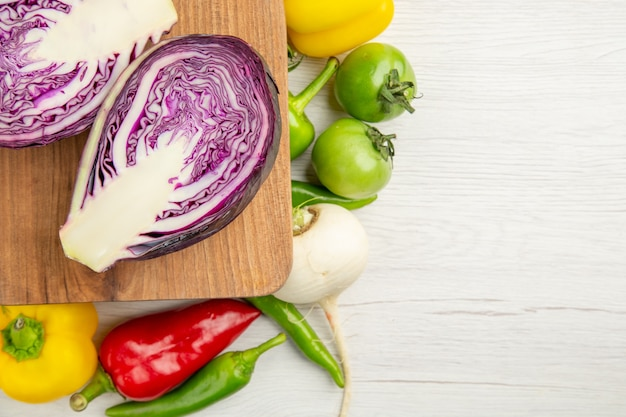 Top view fresh bell-peppers with apples and red cabbage on a white background ripe color  healthy life diet salad