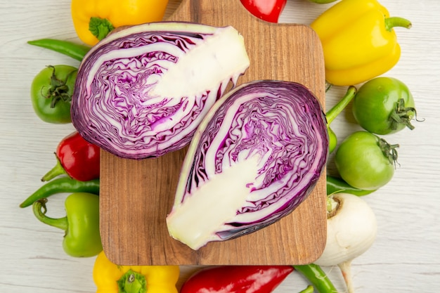 Top view fresh bell-peppers with apples and red cabbage on white background ripe color  healthy life diet salad