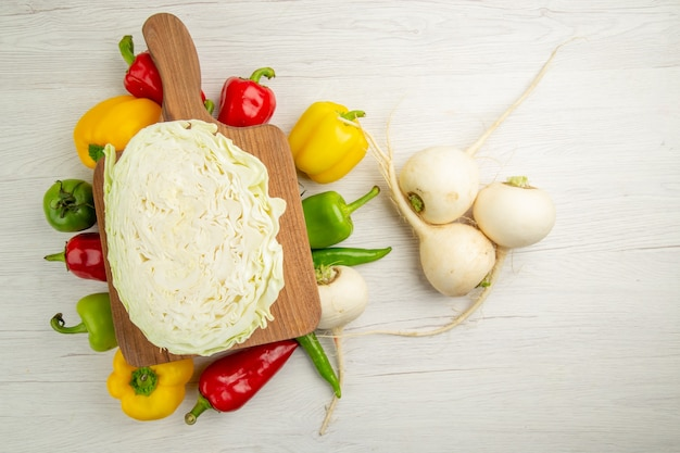 Top view fresh bell-peppers with radish and cabbage on white background diet salad color healthy life photo ripe