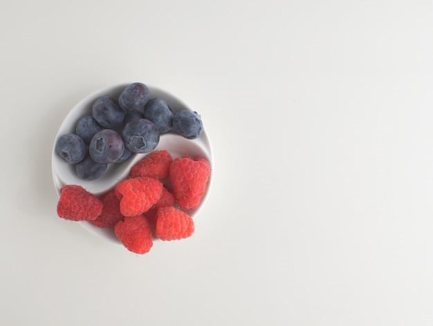 Top view fresh berries blueberries raspberries white  copy space background