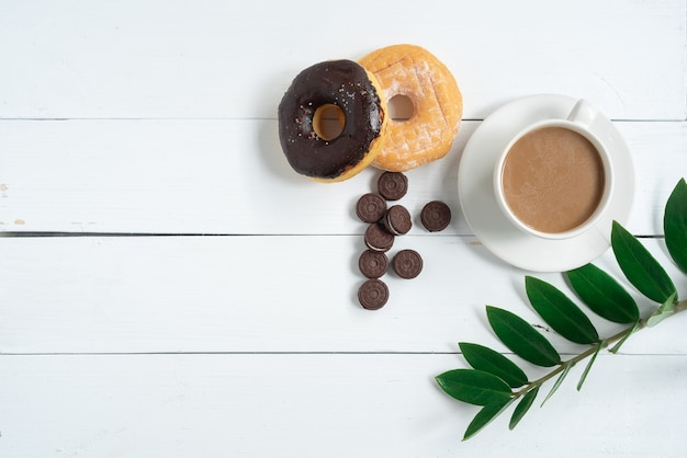 Top view of fresh bread and coffeefern leafmonstera leaf separate on a white background wood